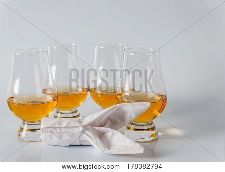 Delicious Single Malt Whiskey Glass With Bunny Napkin On A White Background