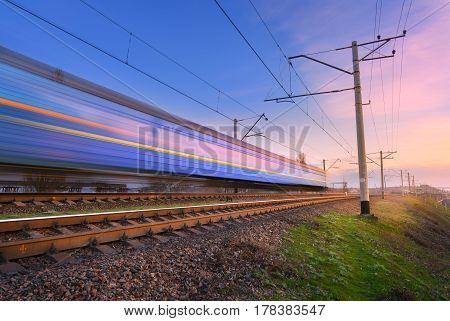High Speed Blue Passenger Train In Motion