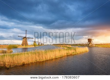 Rustic Landscape With Traditional Dutch Windmills