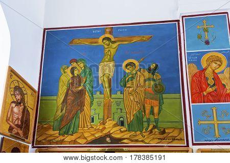 MADABA, JORDAN - NOVEMBER 25, 2016  Jesus Christ Crucifixion Frescos Saint George's Greek Orthodox Church Madaba Jordan. Church was created in the late 1800s and houses many famous mosaics