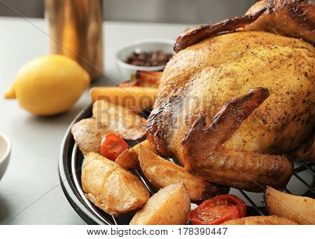 Grilled beer can chicken with vegetables, closeup