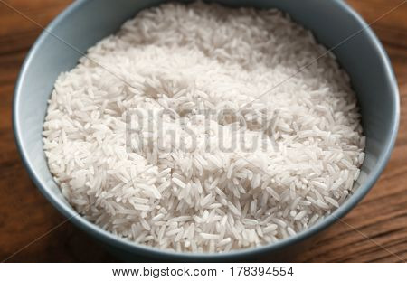 Bowl with rice on kitchen table, closeup