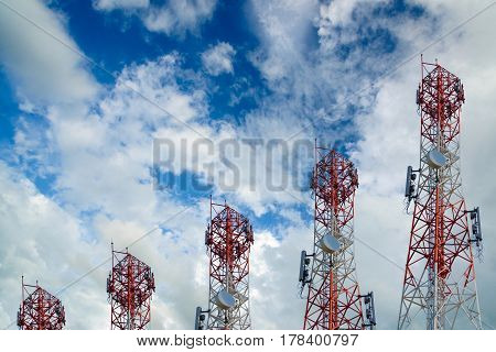 Telecommunication Towers Arranged As A Bar Chart. On Blue Sky And Cloud