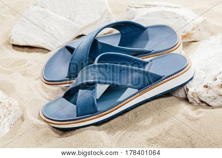 Flip-flops on sand or beach