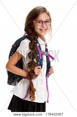 Portrait of happy smiling little girl in glasses with schoolbag