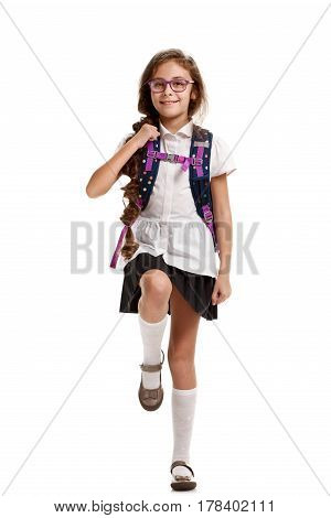 Full portrait of happy cute girl with knapsack going to school
