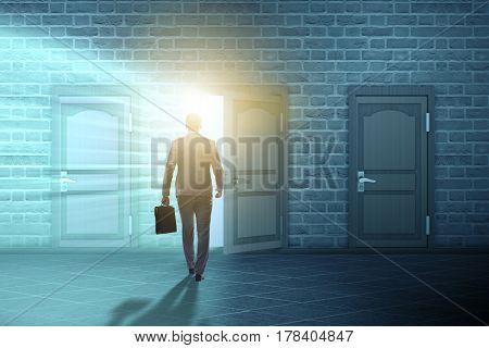 Businessman walking towards open door