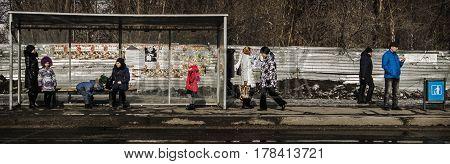 Kazakhstan, Ust-kamenogorsk, march 12, 2017: Bus stop, people waitng the bus