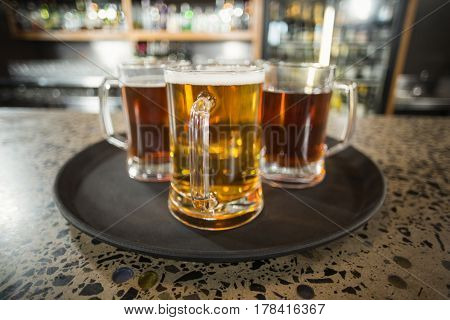 Three glasses of beer in a bar