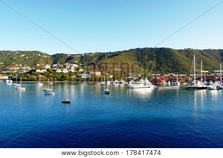 Boats and yachts dot the blue coastal waters fronting Charlotte Amalie in St. Thomas, USVI