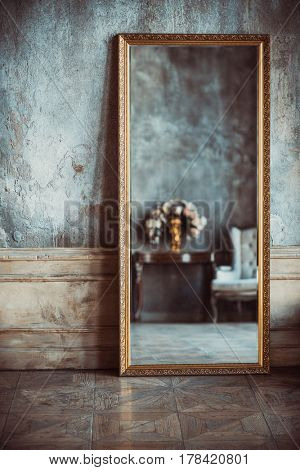 Vintage style interior details. Old wall and mirror with reflection.