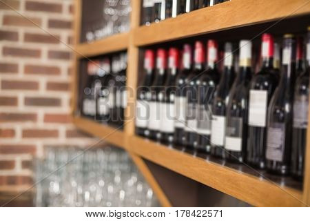 Wine bottles in a shelf at a bar