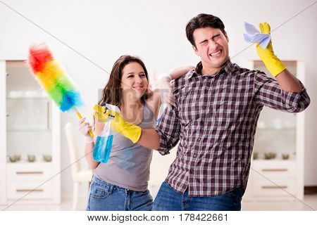 Wife and husband doing cleaning at home