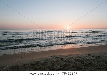 Scenic View Of Sea Against Sky At sunrise in Oliva Valencia Spain