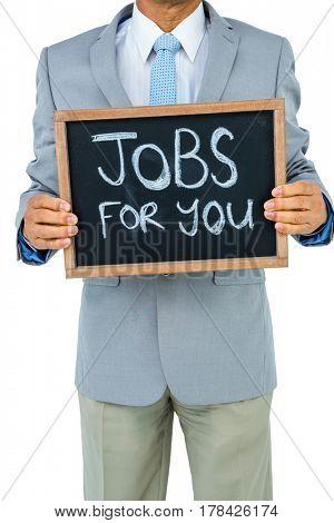 Businessman holding black board on white background