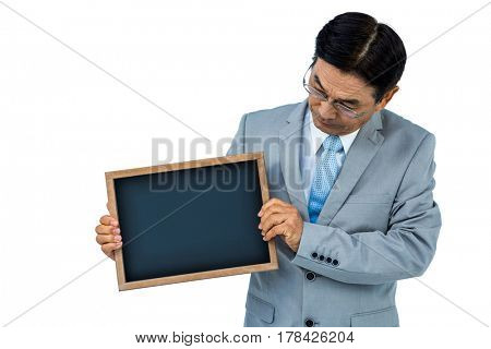 Asian businessman holding a black board on white board