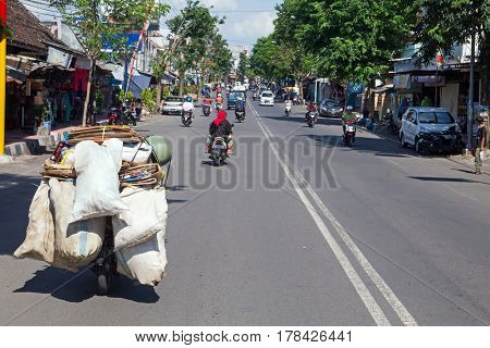 Seller is transporting goods in a village in East Java Indonesian Asia