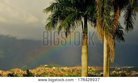 A rainbow appears under the clouds during rains