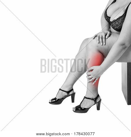 Leg pain fat woman with muscle ache overweight female body isolated on white background black and white photo with red spots