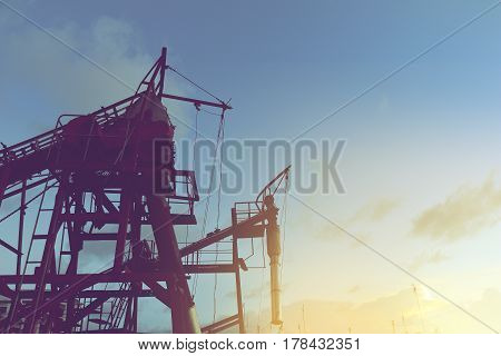 conveyor belts for the mining on sunset sky background