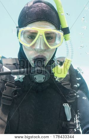 Portrait of young woman on scuba training in swimming pool
