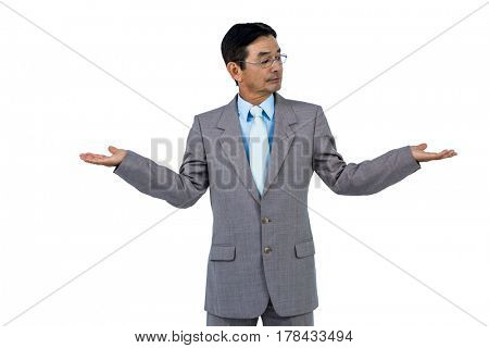 Businessman doing hand gesture on white background
