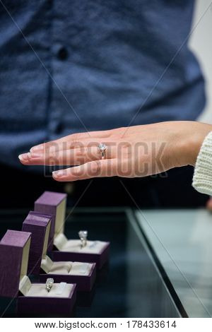 Woman trying a diamond ring in jewelry shop