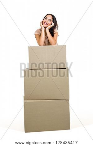 Woman standing with boxes against white background