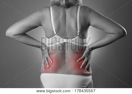 Back pain kidney inflammation ache in woman's body black and white photo with red spots