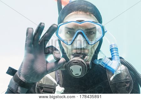 Portrait of young man on scuba training in swimming pool