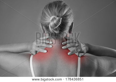 Neck pain massage of female body ache in woman's body black and white photo with red spots