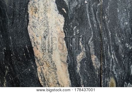 Black marble texture stone background. Wall decoration from marble slabs