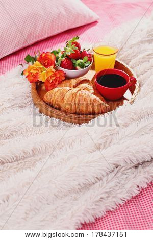 breakfast in bed with coffee croissant and orange juice
