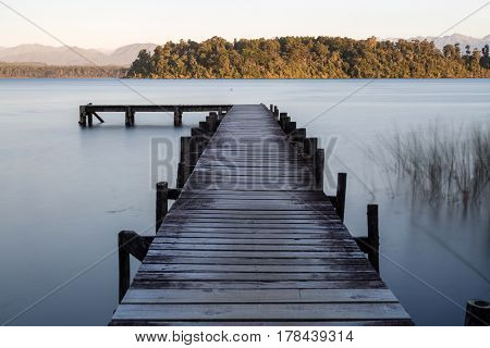 Wooden jetty at the mountain lake