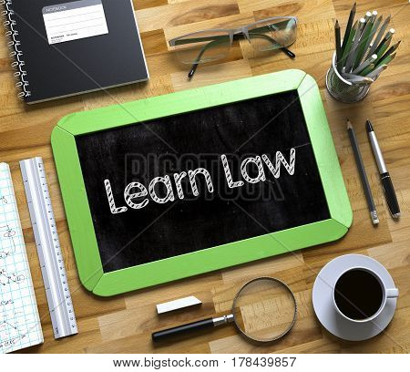 Learn Law - Text on Small Chalkboard. Business Concept Handwritten on Green Small Chalkboard. Top View Composition with Chalkboard and Office Supplies on Office Desk. 3d Rendering.