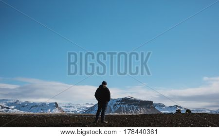 Traveler enjoying beautiful landscaped view in winter, with clear sky