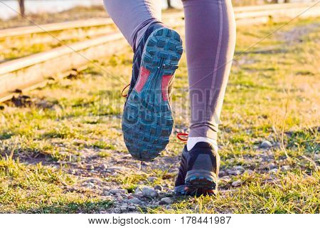 Cross-country Trail Running People At Sunset. Runner Couple Exercising Outside As Part Of Healthy Li