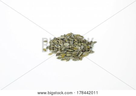 Spilled pumpkin seeds isolated on a white background