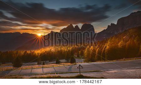Beautiful mountain scenery at sunset near Pordoi pass with a view to Sella pass and Sassolungo - Dolomites Italy.