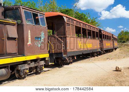 Manaca Iznaga Cuba - January 29 2017: Tourist train in the Valley of the Sugar Mills or Valle de los Ingenios a Unesco World Heritage site and a major tourist landmark in Cuba