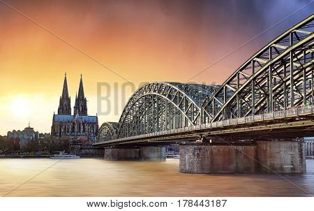 Cologne at sunset Germany with a bridge