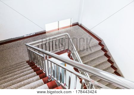 aerial view of empty staircase with stainless railing