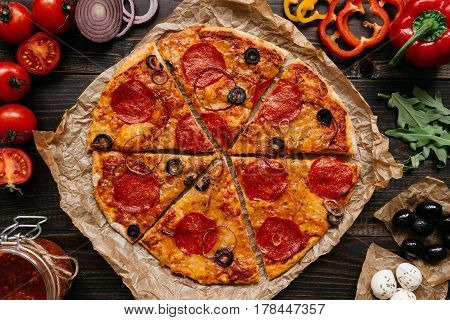 Fresh Delisious Pizza With Pizza Ingredients On The Wooden Table, Top View