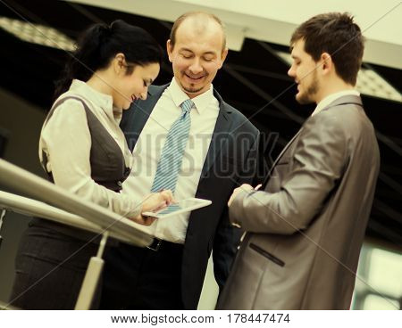 smiling business team discussing something in office