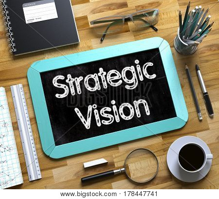 Strategic Vision on Small Chalkboard. Mint Small Chalkboard with Handwritten Business Concept - Strategic Vision - on Office Desk and Other Office Supplies Around. Top View. 3d Rendering.