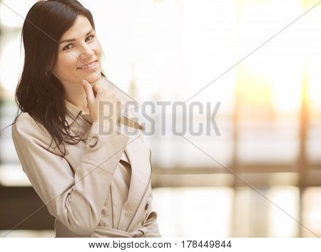 Portrait of a smiling successful business woman, there empty space for text