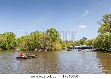 New York USA- May 20 2014. A couple rowing the rowboat in lake of Central Park in New York City USA.
