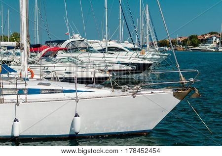 many beautiful moored saiboats in the sea port