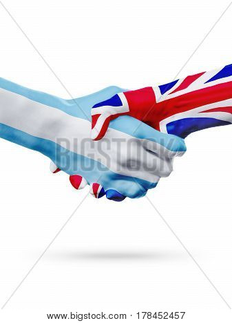 Flags Argentina United Kingdom countries handshake cooperation partnership friendship or national sports team competition concept isolated on white