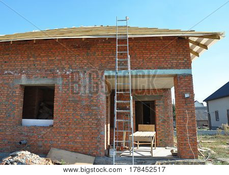 Roofing Construction with Wooden Roof Trusses and Metal Ladder.